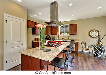 Traditional American kitchen featuring stainless steel...