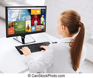 businesswoman with internet page on computer