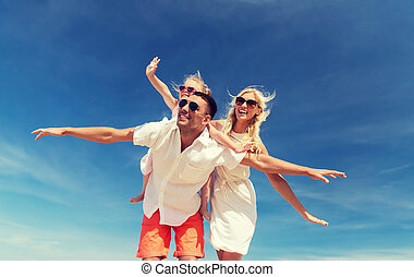 happy family having fun over blue sky background - family,...