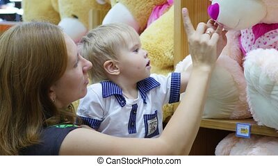 a child plays with a soft toy in the shop