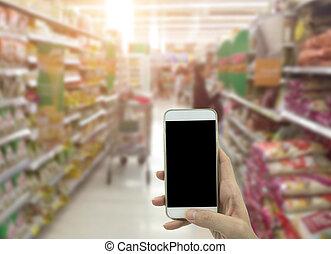 Holding smart phone isolated over white background - mockup...