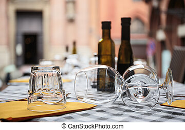 Table setting in a street cafe - Wine glasses on the table...