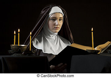Nun with bible.
