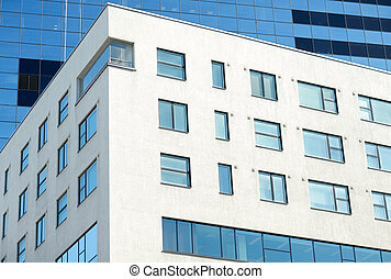 close up of multistory office building in city -...