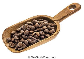 rustic scoop of coffee beans
