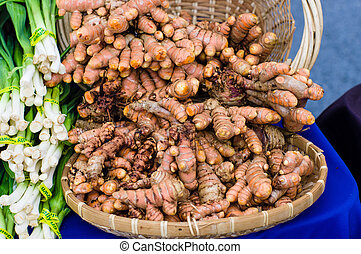 Fresh tumeric root in basket - Fresh tumeric root in a...