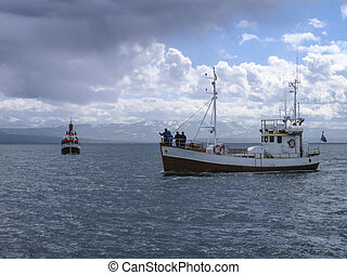 Whale watching ship in Husavik, Iceland. - Whale watching...