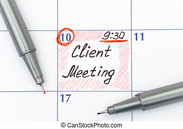 Reminder Client Meeting in calendar with pens