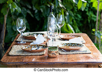 Empty traditional plates with ornaments on a restaurant table in