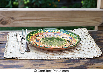 Traditional plate with ornaments on a restaurant table
