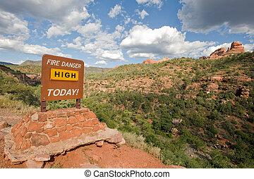 Fire danger warning sign in Arizona wilderness near Sedona,...