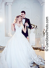 Beautiful young couple, the bride and groom. Luxurious light...
