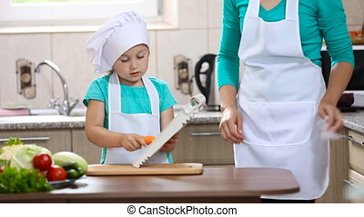 Mom and daughter are preparing carrots