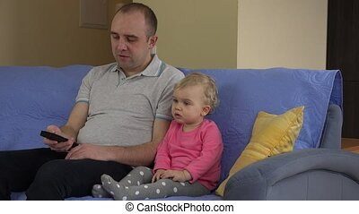 Father change tv channel and daughter girl show negative...