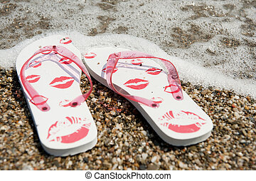 flip flops at the beach - flip flops in the water line at...