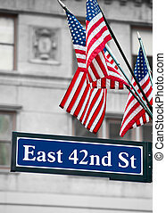 East 42nd Street Signs and US flag in New York city
