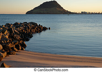 Calm harbour view to Mount Maunganui, New Zealand.