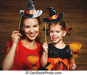 Family fun mother and child daughter celebrate Halloween in...