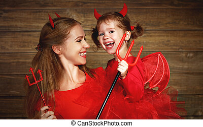 Family mother and child daughter celebrate Halloween in...