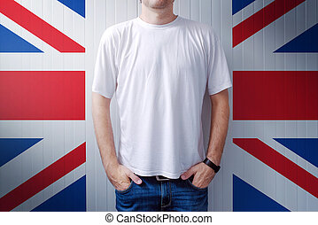 Man standing in front of United Kingdom flag wall, adult...