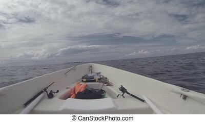 in a fishing motor boat on open water - in a fishing motor...