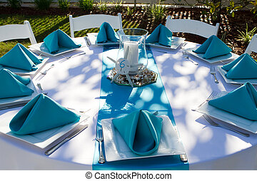 Dinner Table Setup - Outdoor dinner table is setup with...