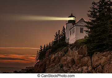 Lighthouse beacon in the night - Bass Harbor Lighthouse in...