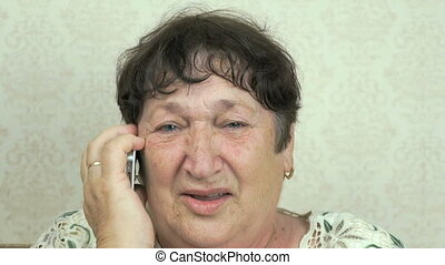 Old woman talking on the mobile phone