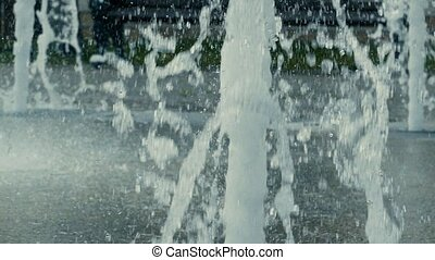 closeup of of water jets slow motion video - closeup of a...