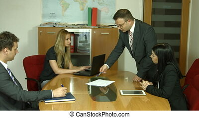 Group of business people planning work in office