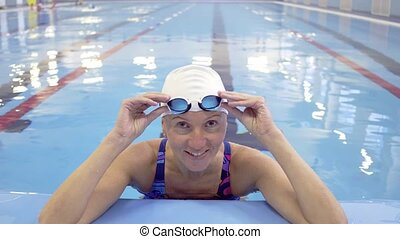 Female Swimmer Training in Swimming Pool