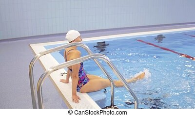 Woman Sitting Near Swimming Pool Stairs