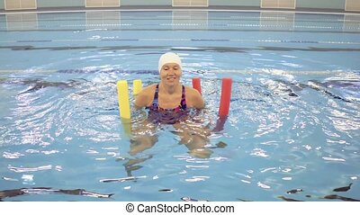 Woman in Aquarobic Fitness Swimming Pool Exercising with...