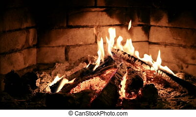 Burning flame fire in a fireplace. Slow motion. - Burning...