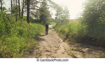 boy walking along the road slow motion video - boy walking...