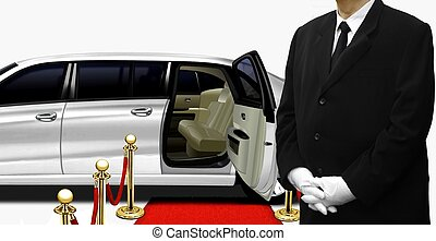 Chauffeur standing by the white limousine
