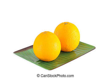 Double oranges on plate isolated with clipping path