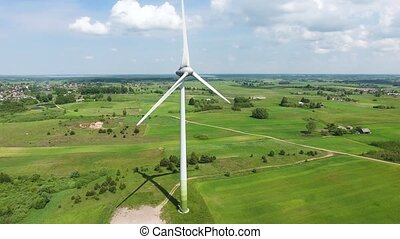 wind turbines in green fields - wind turbines in green...