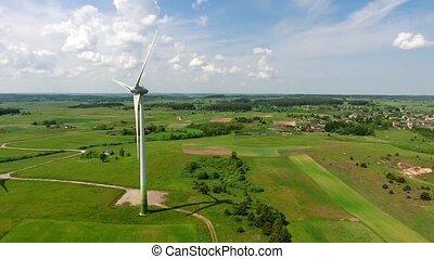 wind turbines in green fields - wind turbines in green...