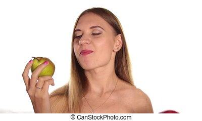 naked young woman wears red lipstick and has her hair down, and brushed, eating a big, juicy pear. healthy food - strong teeth concept. On a white background