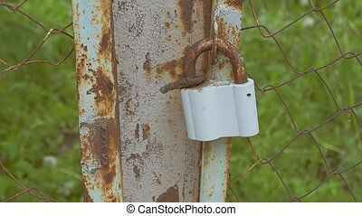 hanging on a chain rusty lock slow motion video - rusty lock...