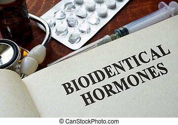 bioidentical hormones - Book with words bioidentical...