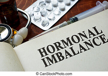 hormonal imbalance - Book with words hormonal imbalance on a...