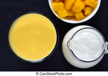 Mango lassi smoothie drink. Top view. - Mango lassi. Mango...