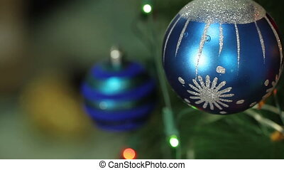 blue ball with garland on a Christmas tree HD