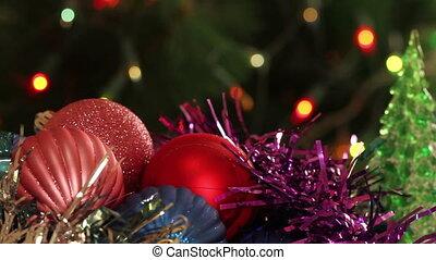Christmas balls and fir tree with garland flashing...