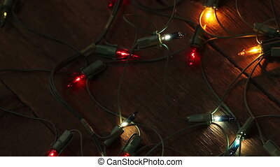 flashing garland on the wooden floor. Christmas background