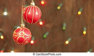 red Christmas balls hanging on strings Flashing a garland...