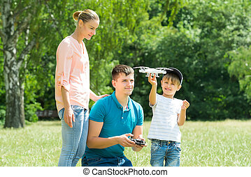 Family Flying Drone In The Park