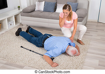Woman Looking At Her Fainted Disabled Father - Shocked Young...